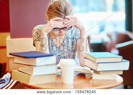 Beautiful Young Student With Lots Of Books