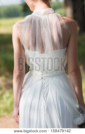 Portrait of a beautiful young bride wearing a slinky dress back