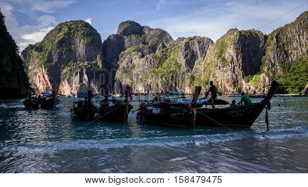 Ko Phi Phi Leh Island, Thailand on November 17, 2016: Longtail boats waiting for passengers at the beach at Maya Bay