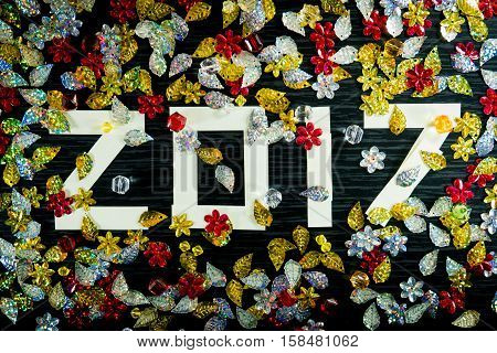happy new year 2017 with colourfull bokeh black colour background