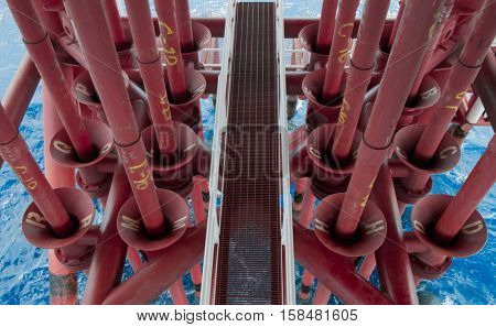 Oil and Gas Producing Slots at Offshore Platform, Oil and Gas Industry. Well head slot on the platform or rig. Production and Explorer industry.