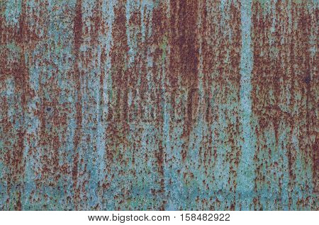 Rusted blue painted metal wall. Texture. Metal