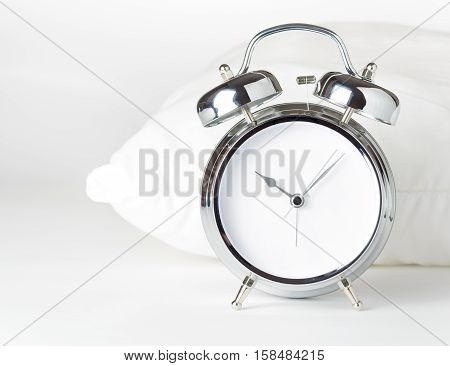 Alarm Clock And White Pillow