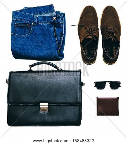 Outfit of business man with vintage blue jeans, black briefcase, brown suede shoes, clubmaster sunglasses and purse on the white isolated background