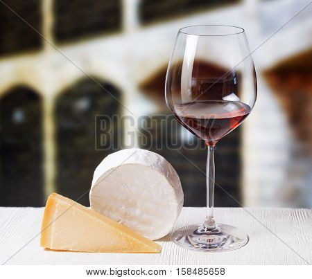 Cheese And Glass Of Red Wine In Winery