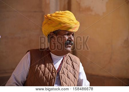 JODHPUR, RAJASTHAN, INDIA - FEBRUARY 10, 2016 - Unidentified Indian man wearing a yellow turban inside Mehrangarh fort