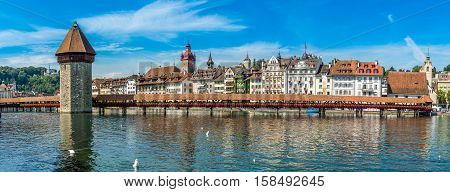 LUZERN,SWITZERLAND - SEPTEMBER 3,2016 - Panoramic view at the Chapel bridge over Reuss river in Luzern. Luzern is a city in central Switzerland.