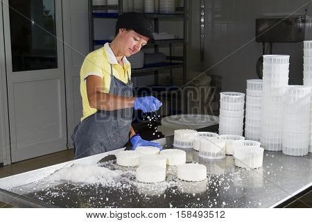 Salting Of A Piece Of Cheese