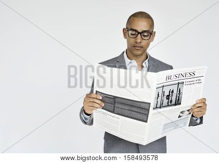Businessman Reading Newspaper Article Journal Concept