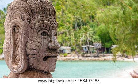 Mystic Skulptur on Haad Salat Beach in Koh Pangan. Hill with Coconut Palms in Background, Thailand