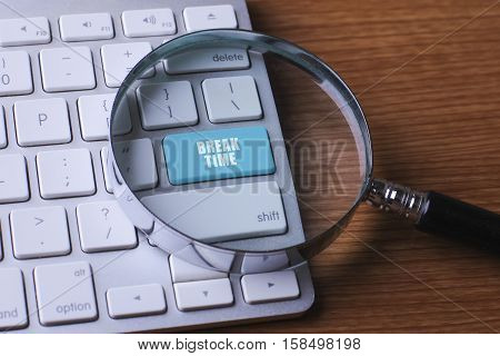 Time concept: computer keyboard with word Break Time selected focus on enter button background