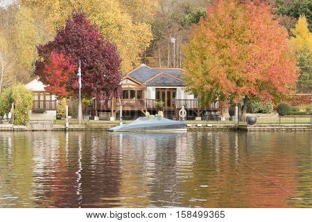 Bright Autumn day by the riverside at Henley-on-Thames Oxfordshire England UK