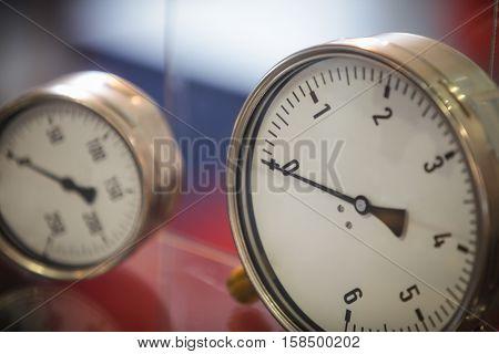 Close up shot of two pressure gauges.