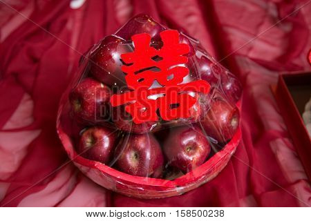 Pile stack of red apple gift with shuang xi double happiness symbol