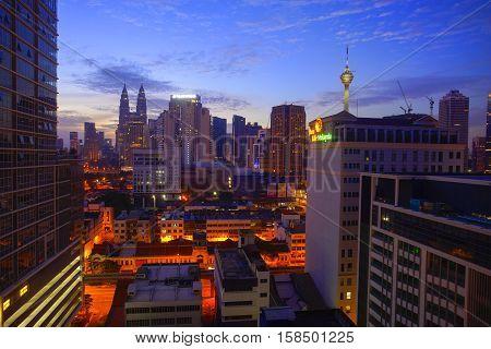 KUALA LUMPUR MALAYSIA - SEPTEMBER 24 2016; Sunrise in the city center and klcc kuala lumpur Malaysia.