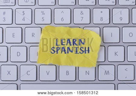 Learn spanish./ Learn spanish card with information on the keyboard