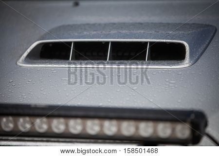 Close up shot of a car's air vents on the scoop.