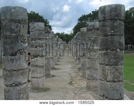 Columns of a maya temple in a walk path - Chichen Itza - Mexico. poster