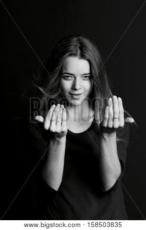The girl with long hair , black and white photo. Gesture come to me.
