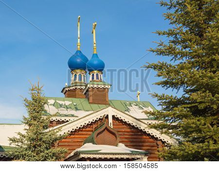 The wooden church decorated with carvings - the sample of Russian wooden architecture
