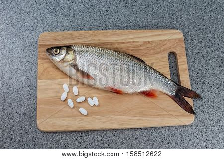 Fish and pills. The risk of food poisoning infection with worms. Or preparation of medicines from fish.
