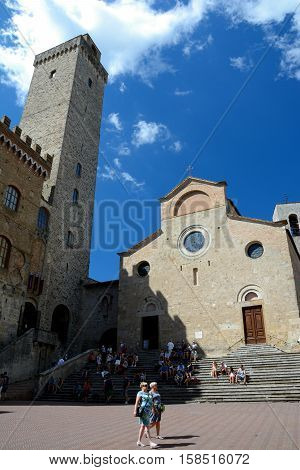 San Gimignano Italy - September 6 2016: Piazza del Duomo square in San Gimignano city in Tuscany Italy. Unidentified people visible.
