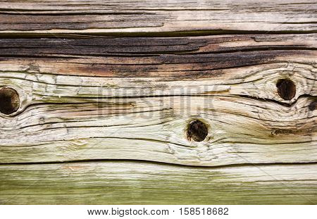 The wall of the old log house. Wooden texture.