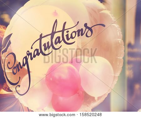 congratulations bolloon with vintage filter colorful background