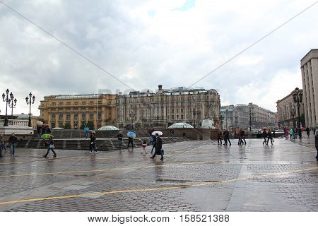 Russia, Moscow 22 May 2016, People at the Manege Square in the rain.