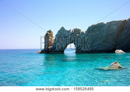 Typical view on Lalaria beach holey rock gate in Skiathos