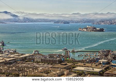 San Francisco, California, United States - August 14, 2016: Aerial view of Alcatraz Island, Hyde Street Pier in Fisherman's Wharf and Maritime National Historical Park, from top of Coit Tower.
