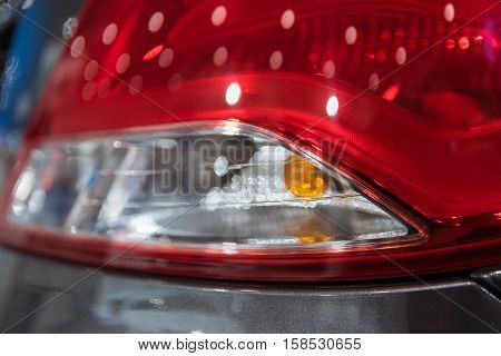 Closeup photograph of rear light of car.