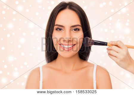 Cheerful Girl Going On Xmas Party And Doing Maquillage With Brush Of Powder