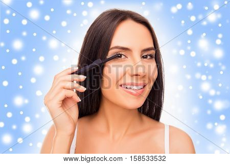 Cute Girl Doing Maquillage With Brash Of Mascara Before New Year Party