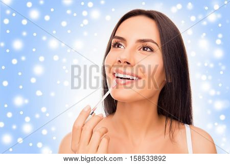 Young Woman Doing Maquillage With Lipstick, Snowy Concept