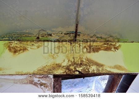 Water leaks on the ceiling Causing damage the ceiling tiles and cement.