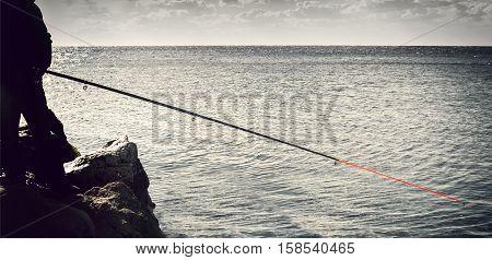 fisherman on the rocks fishing on rocks