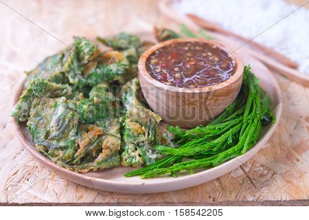 Fried acacia pennata omelet or cha-om eggs with acacia and spicy shrimp paste