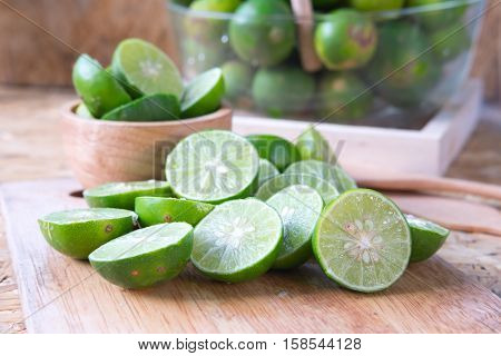 Organic lime on wooden table background slice of lime