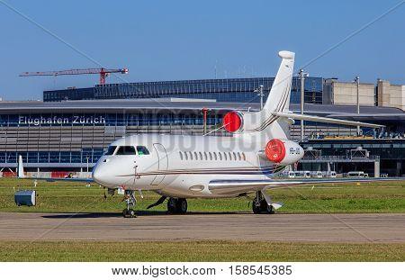 Kloten, Switzerland - 30 September, 2016: Dassault Falcon 7X jet in the Zurich Airport. Zurich Airport, also known as Kloten Airport, is the largest international airport of Switzerland.