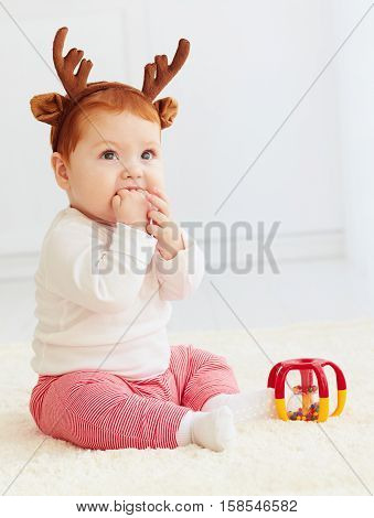 Beautiful Baby Dear Playing With Toy At Home