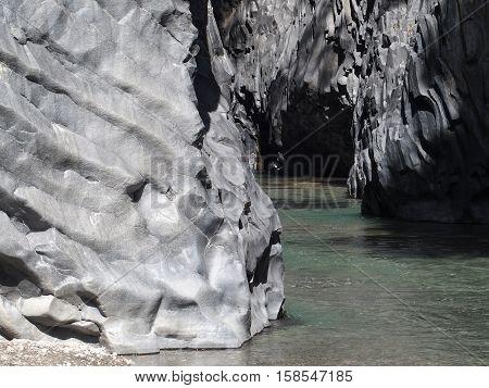 Rocks and river of Alcantara Gorge in May, Sicily, Italy