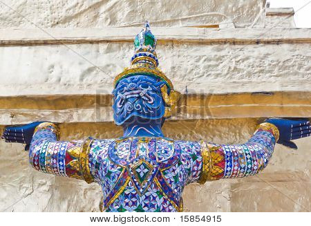 A Giant Blue Body Use Two Hands Carrying A Pagoda Base
