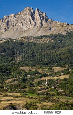 Chabrieres Needles (Aiguilles de Chabrières) and the Village of L'Eglise on a summer afternoon. Hautes Alpes, Southern French Alps, France