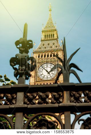 London Big Ben seen throu a decorative fence on a sunny summer day
