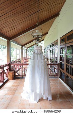 Beautiful white wedding gown hanging before a ceremony.