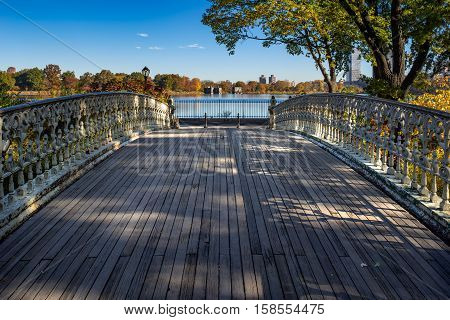 Bridge No. 27 in Central Park with view on the Jacqueline Kennedy Onassis Reservoir in Fall. Upper West Side, Manhattan, New York City