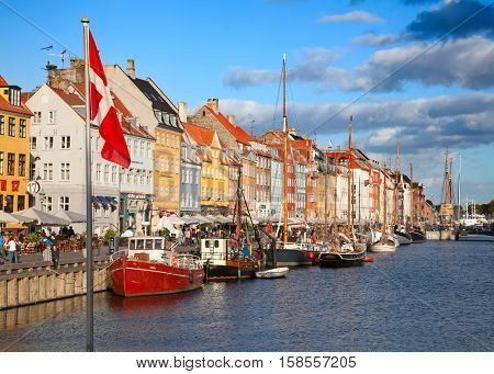 COPENHAGEN, DENMARK - AUGUST 25: unidentified people enjoying sunny weather on the famous Nyhavn promenade on August 25, 2010 in Copenhagen, Denmark. Nyhavn district is famous landmark of Copenhagen.