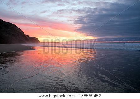 Beautiful sunset at Vale Figueiras beach in Portugal