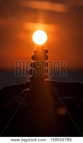Sunset over the far east temple. Abstract, rock formation with sunset